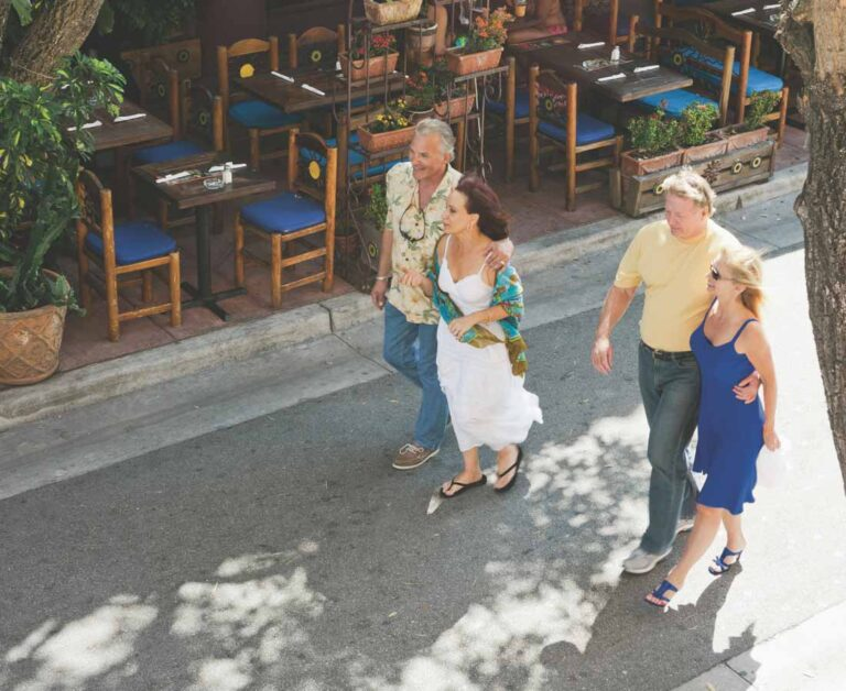 Harbor Belle Whats Nearby couples strolling cafe